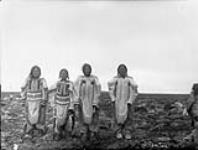 MIKAN 3406576 Four unidentified Inuit women from the lower encampment, Chesterfield Inlet, [N.W.T.], [September 25, 1903.]. September 25, 1903. [53 KB, 600 X 454]