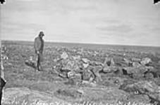 MIKAN 3327780 Ruins of Inuit dwellings at mouth of Chesterfield Inlet, (N.W.T.) 1893. [Ruins of Inuit dwellings at mouth of Chesterfield Inlet, (N.W.T.), 1893.]