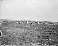 MIKAN 3327782 Ruins of Inuit dwellings at the mouth of Chesterfield Inlet, (N.W.T.) 1893. [Ruins of Inuit dwellings at the mouth of Chesterfield Inlet, (N.W.T.), 1893.]