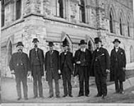 MIKAN 3365779 [Group of Senators near Parliament Building]. ca. 1885. [[Group of Senators near Parliament Building]., ca. 1885.]