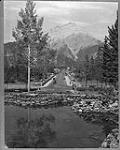 MIKAN 3210974 View from the Banff National Park Administration Building looking along the bridge over the Bow River and Banff Avenue toward Mount Cascade. c 1928 [View from the Banff National Park Administration Building looking along the bridge over the Bow River and Banff Avenue toward Mount Cascade., c 1928]