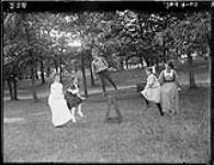 Group on boat swing in Lake Huron Park, [Ont.], 1907. 1907. [187 KB, 1000 X 766]