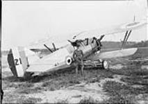 "MIKAN 3642436 F/L Beamish with Armstrong Whitworth ""Siskin"" IIIA aircraft 21 of the RCAF. 24 Aug. 1929 [F/L Beamish with Armstrong Whitworth 'Siskin' IIIA aircraft 21 of the RCAF., 24 Aug. 1929]"