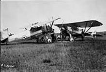 MIKAN 3387958 [Christening of Armstrong Whitworth 'Siskin' IIIA aircraft 20 and 59 as, respectively, 'Lieutenant Sir Arthur Whitten Brown' and 'Captain Sir John Alcock, R.C.A.F. Station Camp Borden, Ont., ca. 1932.]. ca. 1932 [[Christening of Armstrong Whitworth 'Siskin' IIIA aircraft 20 and 59 as, respectively, 'Lieutenant Sir Arthur Whitten Brown' and 'Captain Sir John Alcock, R.C.A.F. Station Camp Borden, Ont., ca. 1932.]., ca. 1932]
