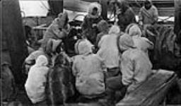 MIKAN 3407942 Inuit aboard H.M.C.S. Karluk at Pt. Barrow [Alaska], visiting, trading and having tea and hardtack, August 1913. 1913 - 1914 [127 KB, 1000 X 585]