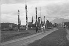 MIKAN 3366565 Totem poles, Kitwanga, B.C. 1948 [Totem poles, Kitwanga, B.C., 1948]