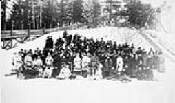 MIKAN 3203665 Princess Louise with group in front of toboggan slide at Rideau Hall. ca. 1880. [100 KB, 600 X 353]