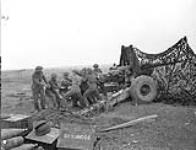 MIKAN 3396146 Gunners of a Medium Regiment of the Royal Canadian Artillery (R.C.A.) cleaning a 5.5-inch gun south of Vaucelles, France, 23 July 1944. July 23, 1944. [Gunners of a Medium Regiment of the Royal Canadian Artillery (R.C.A.) cleaning a 5.5-inch gun south of Vaucelles, France, 23 July 1944., July 23, 1944.]