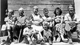 MIKAN 3226671 Dutch Immigrant Settlement - A. Struyck's family on their farm. July 1952 [88 KB, 600 X 336]