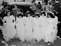 MIKAN 3192104 The Dionne quintuplets and their sisters arrive at Lansdowne Park to take part in a program of religious music during the Marian Congress at which 250,000 Catholics prayed for peace and celebrated the centenary of the Ottawa archdiocese. 18 - 22 June 1947 [56 KB, 640 X 478]