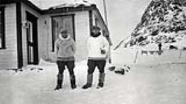 """MIKAN 3227418 """"Mr. Manning and Mr. Ford, Hudson's Bay Co. Post managers at Frobisher Bay,"""" Frobisher Bay, N.W.T. [Iqaluit, Nunavut], Baffin Island, 1927. 1927. [70 KB, 600 X 335]"""