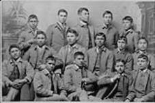 MIKAN 3354520 [Studio portrait of fifteen male students wearing school uniforms, Carlisle Indian Industrial School]. ca. 1888. [[Studio portrait of fifteen male students wearing school uniforms, Carlisle Indian Industrial School]., ca. 1888.]