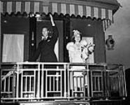 MIKAN 3576380 King George VI and Queen Elizabeth on platform of Royal Train - Royal Tour 1939. May-June 1939 [King George VI and Queen Elizabeth on platform of Royal Train - Royal Tour 1939., May-June 1939]