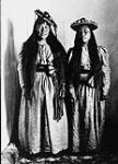 MIKAN 3406556 [Two Inuuk women (woman on the left is Niviaqsarjuk)]. Original title: Natives dressed for dance  1904. [[Two Inuuk women (woman on the left is Niviaqsarjuk)]. Original title: Natives dressed for dance, 1904.]