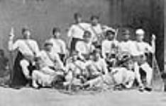 MIKAN 3629758 Des hommes de la Nation mohawk à Kahnawake [Caughnawaga], champions canadiens de crosse en 1869  1869. [Des hommes de la Nation mohawk à Kahnawake [Caughnawaga], champions canadiens de crosse en 1869, 1869.]