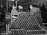 MIKAN 3195458 Hundreds of Bren gun shells stacked neatly in a Canadian munitions plant. The shells await the final tests. Dec. 1939 [80 KB, 640 X 478]