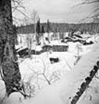 MIKAN 3197742 View of M. Kearney logging camp on a typical winter day. Mar. 1943 [62 KB, 458 X 480]