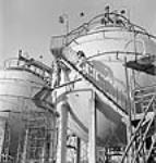 MIKAN 3198116 Workmen tending to Horton Spheres at the Polymer Rubber Corporation. Sept. 1944 [58 KB, 458 X 480]