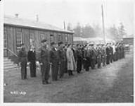 MIKAN 3607566 Under the watchful eyes of veteran soldiers, young Canadians in training line up shortly after arriving in camp at Victoria, B.C. 39 Such camps are scattered across Canada. [Under the watchful eyes of veteran soldiers, young Canadians in training line up shortly after arriving in camp at Victoria, B.C. 39 Such camps are scattered across Canada.]