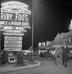 MIKAN 3615424 Montreal night life.  Favourite roadhouse for men-about-town clientele is Ruby Foo's which specializes in Chinese food. April 28, 1951 [Montreal night life. Favourite roadhouse for men-about-town clientele is Ruby Foo's which specializes in Chinese food., April 28, 1951]