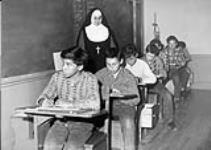 MIKAN 5188742 [Mother Mary Ste-Catherine supervises a class of students]. [between 1900-1976] [[Mother Mary Ste-Catherine supervises a class of students]., [between 1900-1976]]