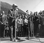 MIKAN 4051955 Trans-Canada Highway - Diefenbaker, Rt. Hon. opening ceremony - safety helmet - mircophones - Rogers Pass, B.C. 1962. [118 KB, 600 X 594]