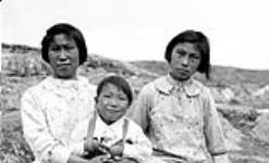 MIKAN 5276139 Unidentified Inuit girls and boy at Kimmirut. July 1934 [Unidentified Inuit girls and boy at Kimmirut., July 1934]