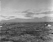 MIKAN 3855423 The community and RCMP Barracks in Chesterfield Inlet (Igluligaarjuk), Nunavut  1948. [The community and RCMP Barracks in Chesterfield Inlet (Igluligaarjuk), Nunavut, 1948.]