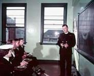 Naval Chaplain discussing group. [132 KB, 1000 X 812]