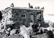MIKAN 4507613 Dogfood house, R.C. Mission, Pelly Bay. ca. 1940. [Dogfood house, R.C. Mission, Pelly Bay., ca. 1940.]