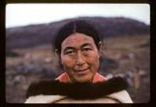 MIKAN 4424920 Close-up photo of a woman at Kinngait, Nunavut. [She has been identified as Aggeok, the wife of Peter Pitseolak.]  ca. 1960. [Close-up photo of a woman at Kinngait, Nunavut. [She has been identified as Aggeok, the wife of Peter Pitseolak.], ca. 1960.]