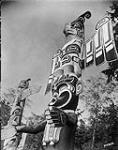 MIKAN 3353854 Totem Pole on Indian Reserve - Thunder Bird Totem. 1938 [Totem Pole on Indian Reserve - Thunder Bird Totem., 1938]