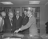 MIKAN 4400345 MIKAN 4400345: Opening of the Jacob Lowy Collection, National Library of Canada. Pictured left to right: Rabbi Reuven Bulka, Rabbi Walter Wurzburger, National Librarian Guy Sylvestre, the Hon. John Roberts and Rabbi Gunther Plaut  [ca 1977]. [Opening of the Jacob Lowy Collection, National Library of Canada. Pictured left to right: Rabbi Reuven Bulka, Rabbi Walter Wurzburger, National Librarian Guy Sylvestre, the Hon. John Roberts and Rabbi Gunther Plaut, [ca 1977].]