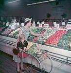 MIKAN 4292668 A housewife and her son shop in an Ottawa chain store. June 1949 [206 KB, 1000 X 1024]