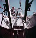 MIKAN 4293138 Man on ship. July 1954 [150 KB, 1000 X 1050]