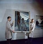 MIKAN 4316835 MIKAN 4316835: Deux hommes installant le tableau Blunden Harbour d'Emily Carr à la Galerie nationale du Canada  [entre 1955-1963] [Deux hommes installant le tableau Blunden Harbour d'Emily Carr à la Galerie nationale du Canada, [entre 1955-1963]]