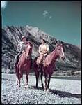 MIKAN 4312193 Trail Riders, Waterton National Park, Alberta. Deux jeunes femmes font de l'équitation  [Deux jeunes femmes font de l'équitation, parc national des Lacs-Waterton, Alberta.] septembre 1948. [Trail Riders, Waterton National Park, Alberta. Deux jeunes femmes font de l'équitation, septembre 1948.]