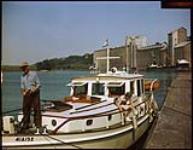 MIKAN 4312276 W.E. Lyman of Sandusky, Ohio aboard yacht docked at Goderich, Ontario.  [W.E. Lyman de Sandusky, Ohio à board un yacht amarré à Goderich, Ontario. 1949. [163 KB, 1000 X 777]