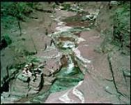 MIKAN 4312291 A close-up of Red Rock Canyon, Waterton Lakes National Park, Alberta.   [Red Rock Canyon, parc national des Lacs-Waterton, Alberta.] 1949. [288 KB, 1000 X 796]