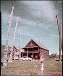 MIKAN 4311960 Totem poles at Kispiox Indian Village, near Hazelton, B.C.  1949. [Totem poles at Kispiox Indian Village, near Hazelton, B.C., 1949.]
