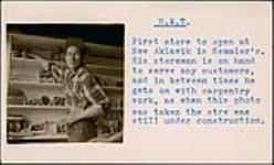 MIKAN 5196011 [Semmler's store employee stocking shelves in New Aklavik]. [between 1955-1963] [[Semmler's store employee stocking shelves in New Aklavik]., [between 1955-1963]]