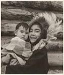 MIKAN 5196033 [Eunice Gordon holding her brother Andrew]. [between 1955-1963] [[Eunice Gordon holding her brother Andrew]., [between 1955-1963]]