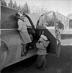 MIKAN 5196070 [Two young children in the doorway of an automobile]. [between 1955-1963] [[Two young children in the doorway of an automobile]., [between 1955-1963]]