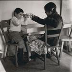 MIKAN 5196086 [John Houston and an Inuk girl clinking glasses]. [between 1956-1960] [[John Houston and an Inuk girl clinking glasses]., [between 1956-1960]]