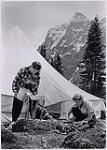 MIKAN 5196113 [Katherine Capes and another woman doing chores in camp]. [between 1953-1964] [[Katherine Capes and another woman doing chores in camp]., [between 1953-1964]]