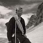 MIKAN 5196139 [Photograph depicting a male mountaineer wearing glasses with rope over his shoulder]. [between 1953-1964] [[Photograph depicting a male mountaineer wearing glasses with rope over his shoulder]., [between 1953-1964]]