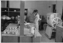 MIKAN 4322281 Two Aboriginal women working at the old Nursing Station, Aklavik, NWT. 1975 [125 KB]