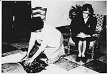 MIKAN 4322332 Nurse watching Aboriginal woman practice first aid techniques. n.d. [110 KB]