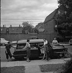 MIKAN 4306200 Helen Salkeld, Audrey James, Anna Brown and Rosemary Gilliat (left to right) getting ready to leave Ottawa, Ontario for their Trans-Canada Highway trip  July 31, 1954. [166 KB, 1000 X 1005]