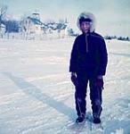 MIKAN 4323876 Boy on snow skis, Dillon, Saskatchewan [The late Wapiskî Miskinâhk (White Turtle). He was also known as Armand Bekkattla]  March, 1955. [158 KB, 1000 X 1025]